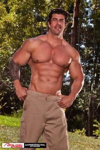'Wood'-Raging-Stallion-Zeb-Atlas-chest-muscle-smile